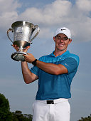 Rory McIlroy of Northern Ireland poses with the trophy after his win on the 18th hole during the final round at the Wells Fargo Championship at Quail...