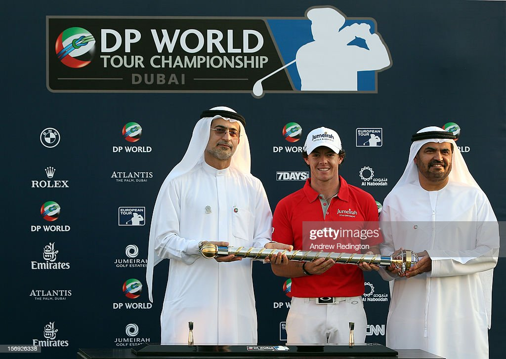 Rory McIlroy of Northern Ireland (C) poses with the trophy alongside Mohammed Sharaf ,Group CEO DP World, (L) and Abdul Hamied Siddeqi, Vice Chairman, Ahmed Seddiqi & Sons, (R) after winning the DP World Tour Championship on the Earth Course at Jumeirah Golf Estates on November 25, 2012 in Dubai, United Arab Emirates.