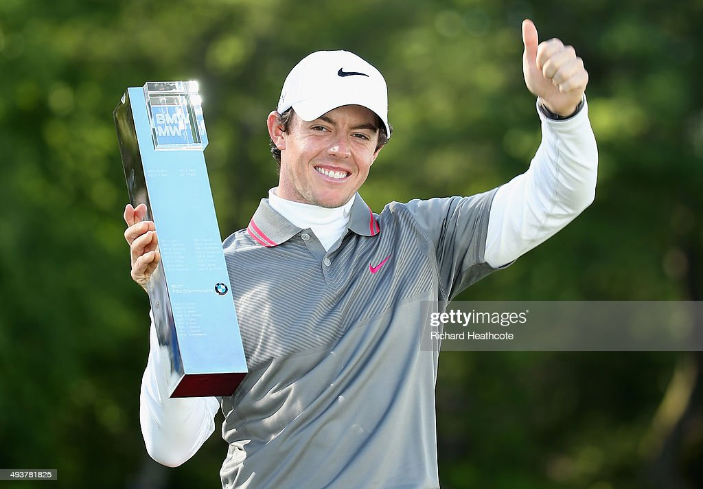 Rory McIlroy of Northern Ireland poses with the trophy following his victory at the end of day four of the BMW PGA Championship at Wentworth on May...