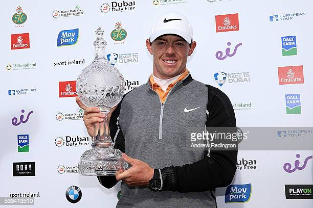 Rory McIlroy of Northern Ireland poses with the trophy following his victory during the final round of the Dubai Duty Free Irish Open Hosted by the...