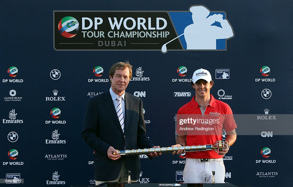 Rory McIlroy of Northern Ireland (R) poses with the trophy next to George O'Grady, Chief Executive of The European Tour, after winning the DP World Tour Championship on the Earth Course at Jumeirah Golf Estates on November 25, 2012 in Dubai, United Arab Emirates.