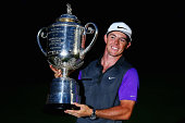 Rory McIlroy of Northern Ireland poses with the Wanamaker trophy after his onestroke victory during the final round of the 96th PGA Championship at...
