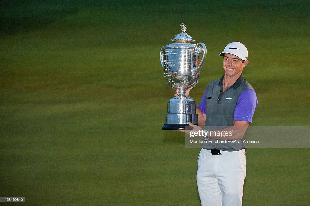 Rory McIlroy of Northern Ireland poses with the Wanamaker Trophy after his win during the Final Round of the 96th PGA Championship at Valhalla Golf...