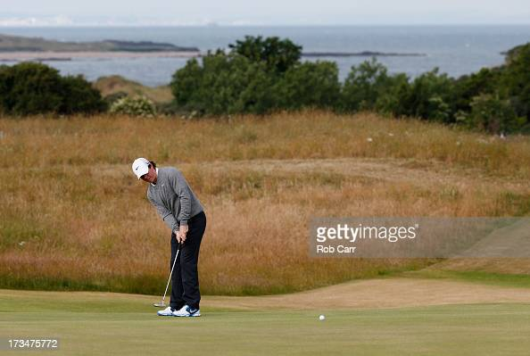 Rory McIlroy of Northern Ireland putts ahead of the 142nd Open Championship at Muirfield on July 15 2013 in Gullane Scotland