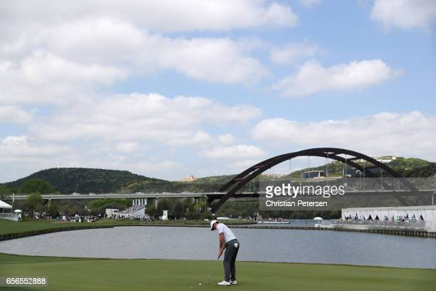 Rory McIlroy of Northern Ireland putts on the 13th hole of his match during round one of the World Golf ChampionshipsDell Technologies Match Play at...