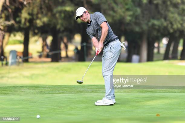 Rory McIlroy of Northern Ireland putts on the 16th hole green during the final round of the World Golf ChampionshipsMexico Championship at Club de...