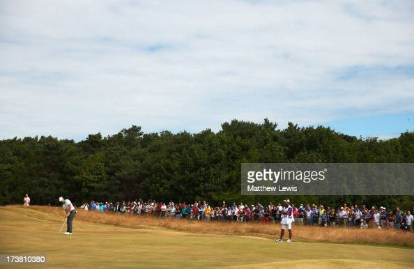 Rory McIlroy of Northern Ireland putts on the 8th hole during the first round of the 142nd Open Championship at Muirfield on July 18 2013 in Gullane...