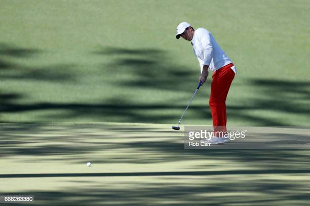 Rory McIlroy of Northern Ireland putts on the tenth hole during the third round of the 2017 Masters Tournament at Augusta National Golf Club on April...