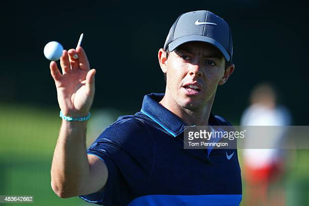 Rory McIlroy of Northern Ireland reaches for a golf ball on the practice ground during a practice round prior to the 2015 PGA Championship at...