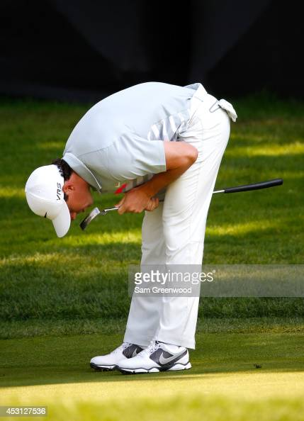 Rory McIlroy of Northern Ireland reacts after a putt on the tenth green during the final round of the World Golf ChampionshipsBridgestone...