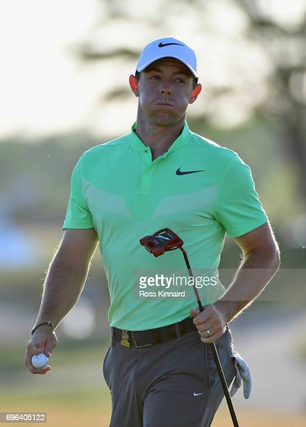 Rory McIlroy of Northern Ireland reacts after finishing on the 18th green during the first round of the 2017 US Open at Erin Hills on June 15 2017 in...