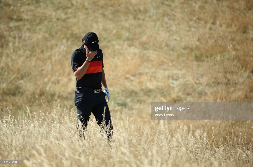 Rory McIlroy of Northern Ireland reacts after he hits a shot on the 6th hole during the second round of the 142nd Open Championship at Muirfield on July 19, 2013 in Gullane, Scotland.