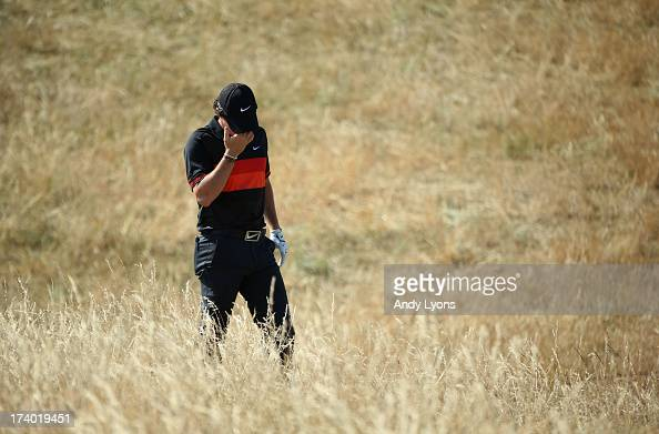 Rory McIlroy of Northern Ireland reacts after he hits a shot on the 6th hole during the second round of the 142nd Open Championship at Muirfield on...