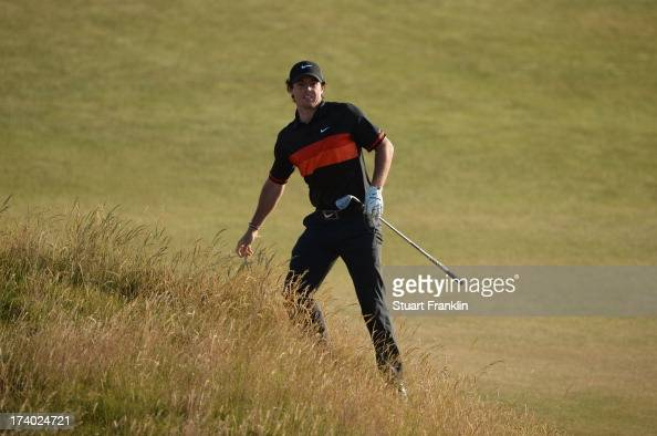 Rory McIlroy of Northern Ireland reacts after he hits a shot on the 17th during the second round of the 142nd Open Championship at Muirfield on July...