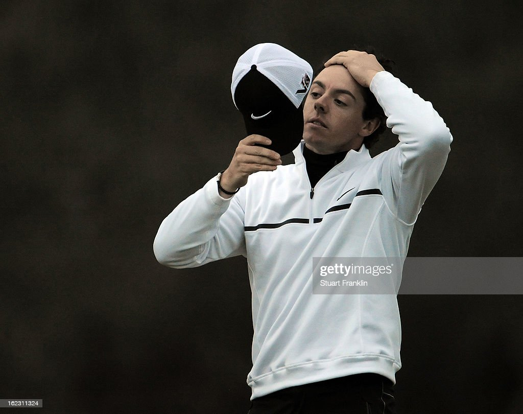 <a gi-track='captionPersonalityLinkClicked' href=/galleries/search?phrase=Rory+McIlroy&family=editorial&specificpeople=783109 ng-click='$event.stopPropagation()'>Rory McIlroy</a> of Northern Ireland reacts after he lost his match to Shane Lowry of Ireland during the first round of the World Golf Championships - Accenture Match Play at the Golf Club at Dove Mountain on February 21, 2013 in Marana, Arizona. Round one play was suspended on February 20 due to inclimate weather and is scheduled to be continued today. Lowry won 1 up in 18 holes.