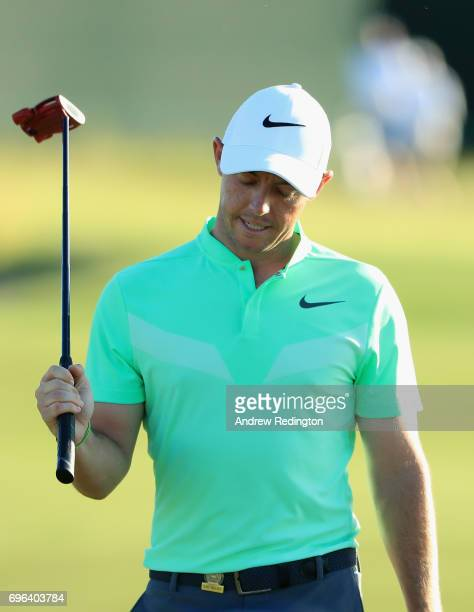 Rory McIlroy of Northern Ireland reacts after his putt on the 18th green during the first round of the 2017 US Open at Erin Hills on June 15 2017 in...