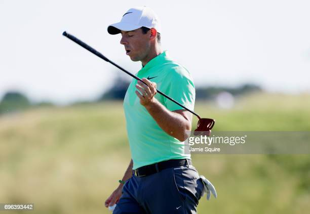 Rory McIlroy of Northern Ireland reacts after making a bogey on the 13th green during the first round of the 2017 US Open at Erin Hills on June 15...