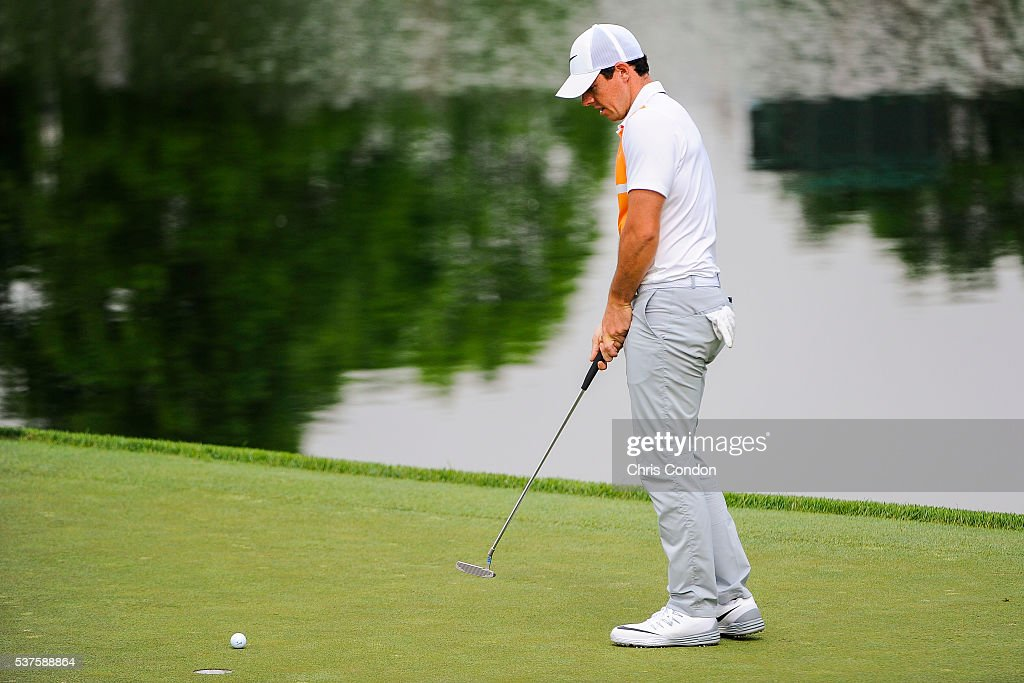 Rory McIlroy of Northern Ireland reacts after missing a bogey putt on the 16th hole green during the first round of the Memorial Tournament presented...