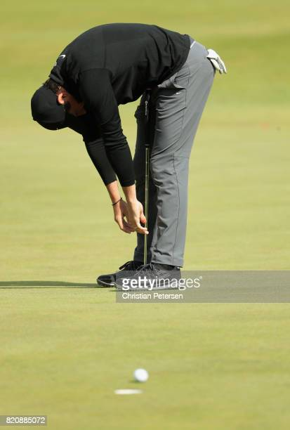 Rory McIlroy of Northern Ireland reacts after missing an eagle putt on the 5th hole during the third round of the 146th Open Championship at Royal...
