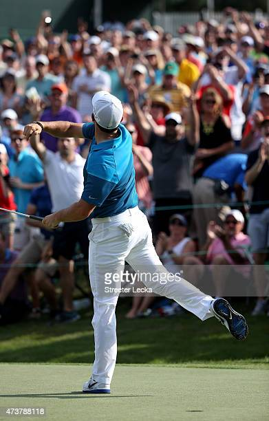 Rory McIlroy of Northern Ireland reacts after putting in to win on the 18th hole during the final round at the Wells Fargo Championship at Quail...