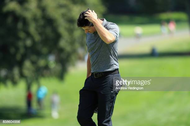 Rory McIlroy of Northern Ireland reacts after putting on the 18th green during round one of The Northern Trust at Glen Oaks Club on August 24 2017 in...