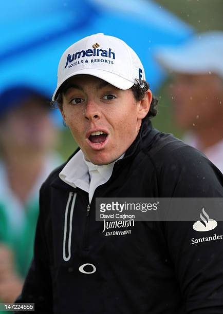 Rory McIlroy of Northern Ireland reacts as a spectator is hit by an errant ball during the proam for the 2012 Irish Open held on the Dunluce Links at...