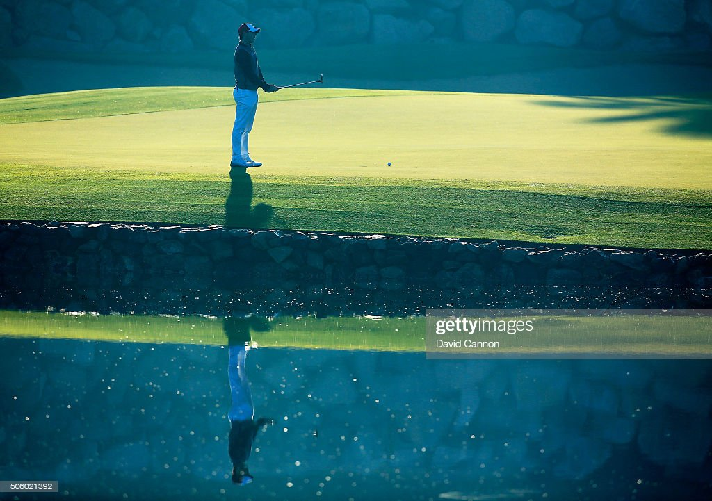 Rory McIlroy of Northern Ireland reacts as he just misses a short birdie putt at the par 3, 12th hole during the first round of the 2016 Abu Dhabi HSBC Golf Championship at the Abu Dhabi Golf Club on January 21, 2016 in Abu Dhabi, United Arab Emirates.