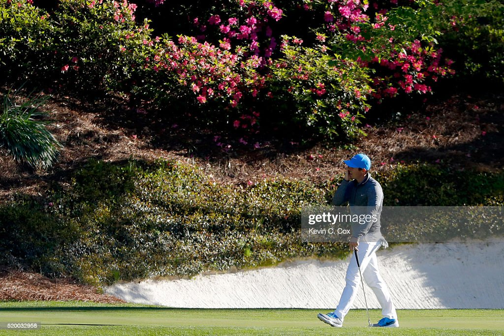 Rory McIlroy of Northern Ireland reacts on the 12th green during the third round of the 2016 Masters Tournament at Augusta National Golf Club on...