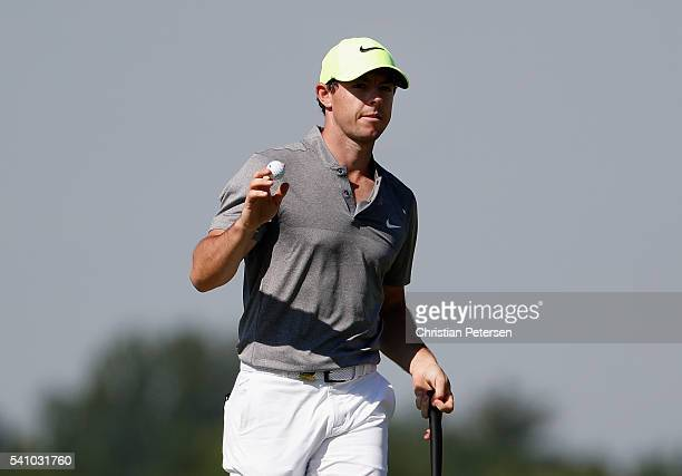Rory McIlroy of Northern Ireland reacts on the 12th green during the continuation of the second round of the US Open at Oakmont Country Club on June...
