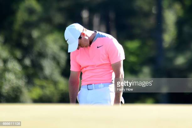 Rory McIlroy of Northern Ireland reacts on the 18th green during the final round of the 2017 Masters Tournament at Augusta National Golf Club on...