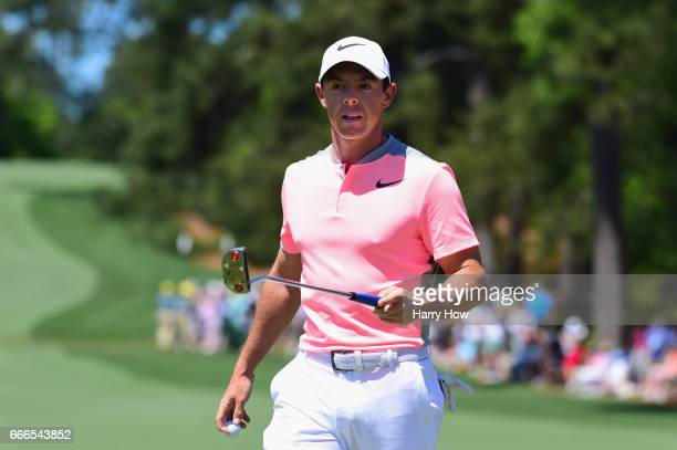 Rory McIlroy of Northern Ireland reacts to a birdie on the second hole during the final round of the 2017 Masters Tournament at Augusta National Golf...