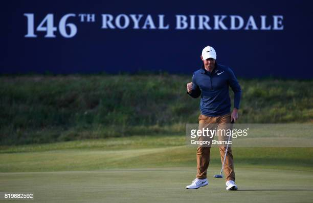 Rory McIlroy of Northern Ireland reacts to a birdie putt on the 18th green during the first round of the 146th Open Championship at Royal Birkdale on...