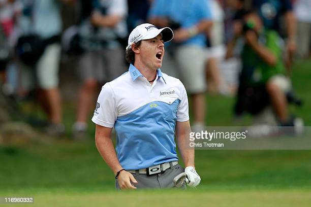 Rory McIlroy of Northern Ireland reacts to a bunker shot on the fourth hole during the third round of the 111th US Open at Congressional Country Club...