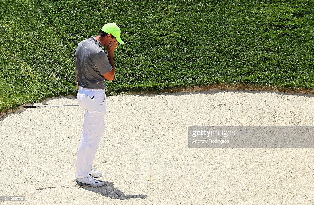 <a gi-track='captionPersonalityLinkClicked' href=/galleries/search?phrase=Rory+McIlroy&family=editorial&specificpeople=783109 ng-click='$event.stopPropagation()'>Rory McIlroy</a> of Northern Ireland reacts to a bunker shot on the ninth hole during the continuation of the second round of the U.S. Open at Oakmont Country Club on June 18, 2016 in Oakmont, Pennsylvania.