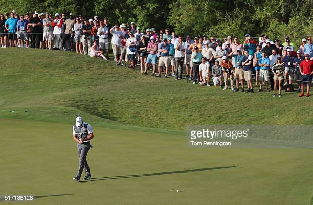 Rory McIlroy of Northern Ireland reacts to a missed putt on the 16th green during the first round of the World Golf ChampionshipsDell Match Play at...