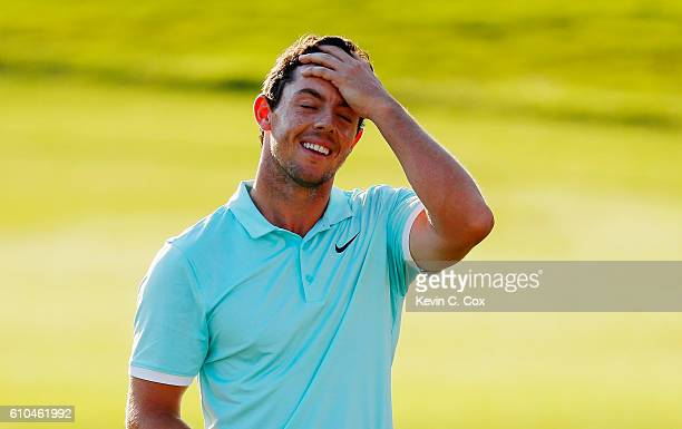 Rory McIlroy of Northern Ireland reacts to a missed putt on the 18th green during the final round of the TOUR Championship at East Lake Golf Club on...