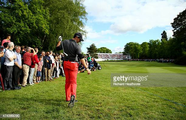 Rory McIlroy of Northern Ireland reacts to his 2nd shot on the 18th hole during day 2 of the BMW PGA Championship at Wentworth on May 22 2015 in...