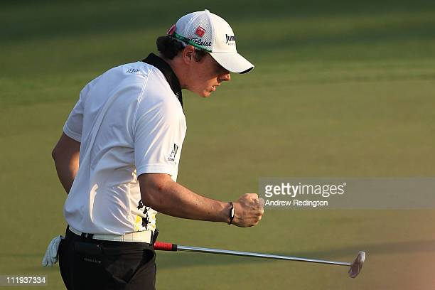 Rory McIlroy of Northern Ireland reacts to his birdie putt on the 17th green during the third round of the 2011 Masters Tournament at Augusta...