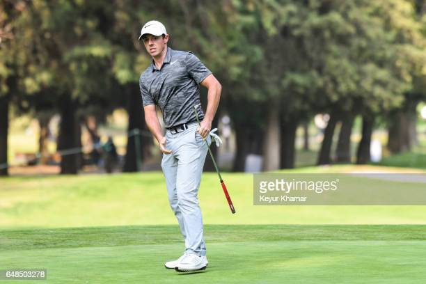 Rory McIlroy of Northern Ireland reacts to his putt on the 16th hole green during the final round of the World Golf ChampionshipsMexico Championship...