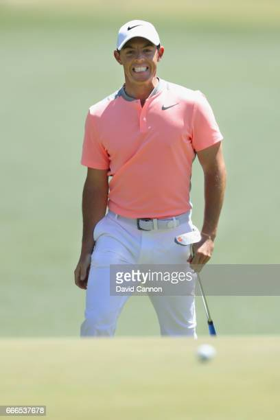 Rory McIlroy of Northern Ireland reacts to his putt on the first hole during the final round of the 2017 Masters Tournament at Augusta National Golf...