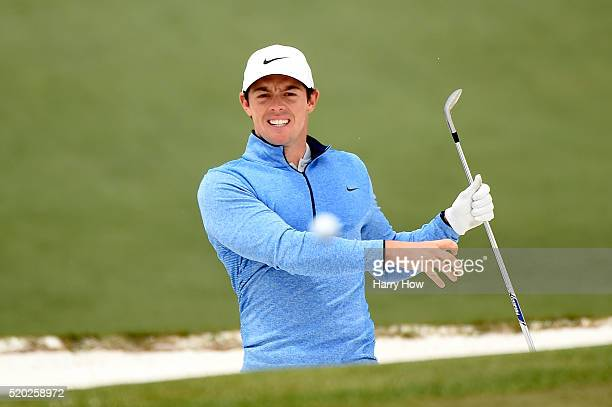 Rory McIlroy of Northern Ireland reacts to his shot from the bunker on the second hole during the final round of the 2016 Masters Tournament at...