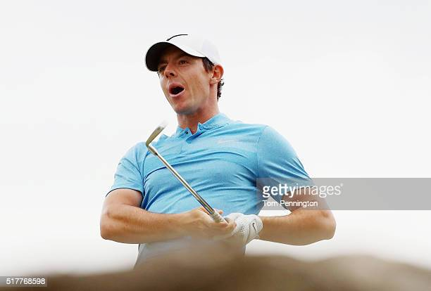 Rory McIlroy of Northern Ireland reacts to his tee shot on the seventh hole during his semifinal match with Jason Day at the World Golf...