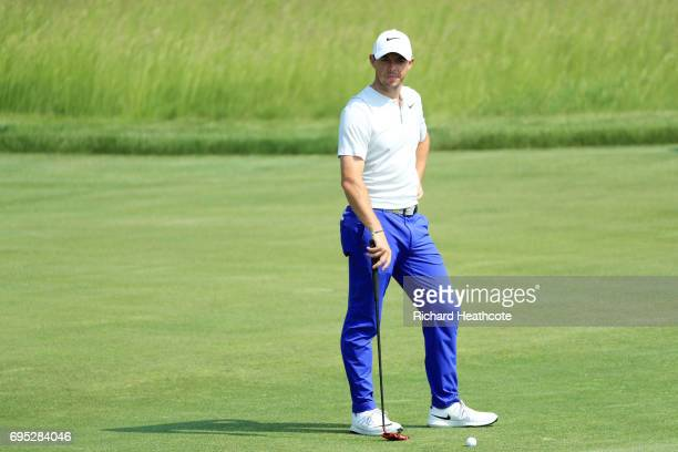 Rory McIlroy of Northern Ireland reacts while putting during a practice round prior to the 2017 US Open at Erin Hills on June 12 2017 in Hartford...