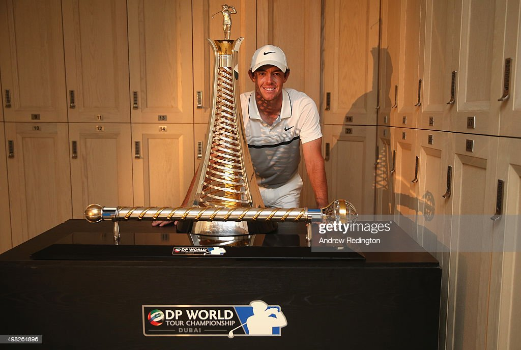 Rory McIlroy of Northern Ireland Rory McIlroy of Northern Ireland poses with the Race To Dubai and DP World Tour Championship trophies in the locker room following the final round of the DP World Tour Championship on the Earth Course at Jumeirah Golf Estates on November 22, 2015 in Dubai, United Arab Emirates.