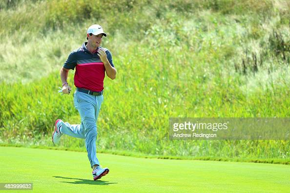 Rory McIlroy of Northern Ireland runs across the fifth tee box during the second round of the 2015 PGA Championship at Whistling Straits on August 14...
