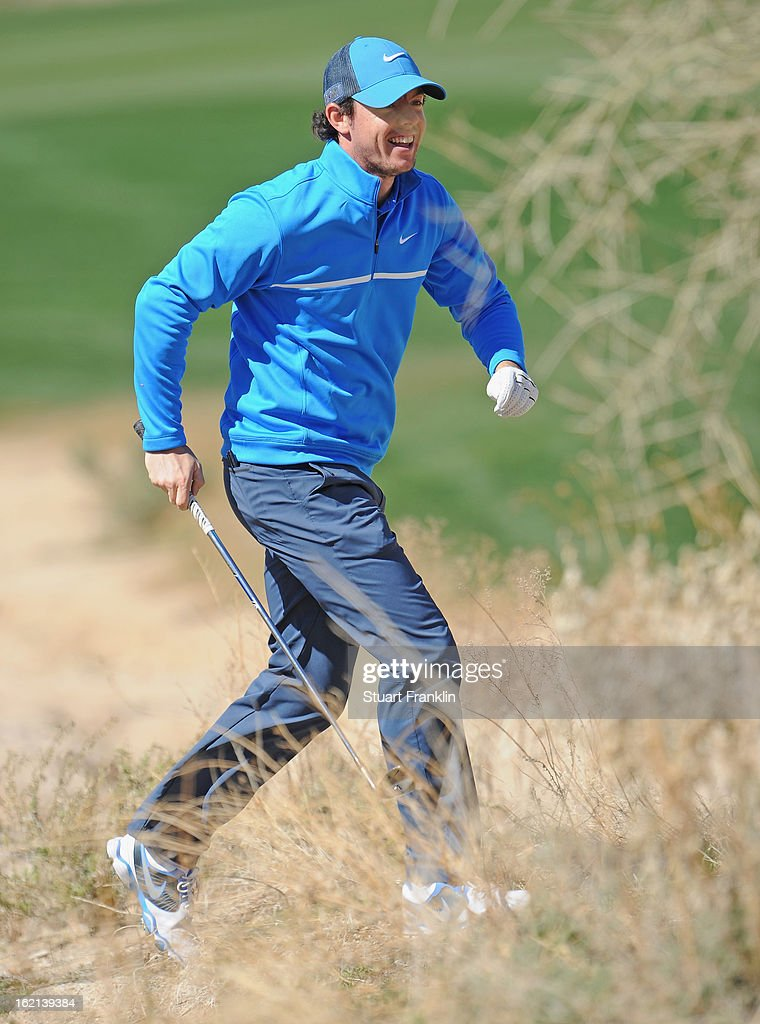 <a gi-track='captionPersonalityLinkClicked' href=/galleries/search?phrase=Rory+McIlroy&family=editorial&specificpeople=783109 ng-click='$event.stopPropagation()'>Rory McIlroy</a> of Northern Ireland runs after a shot during practice prior to the start of the World Golf Championships-Accenture Match Play Championship at the Ritz-Carlton Golf Club on February 19, 2013 in Marana, Arizona.