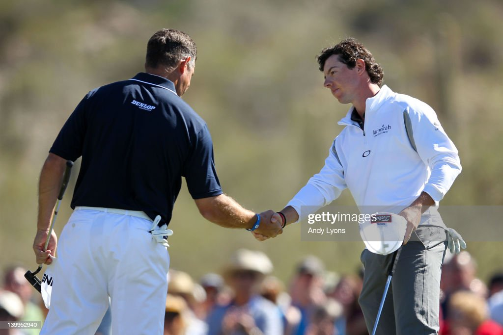 Rory McIlroy of Northern Ireland shakes hands with Lee Westwood of England after winning their match 3 and 1 on the 17th hole during the semifinal...