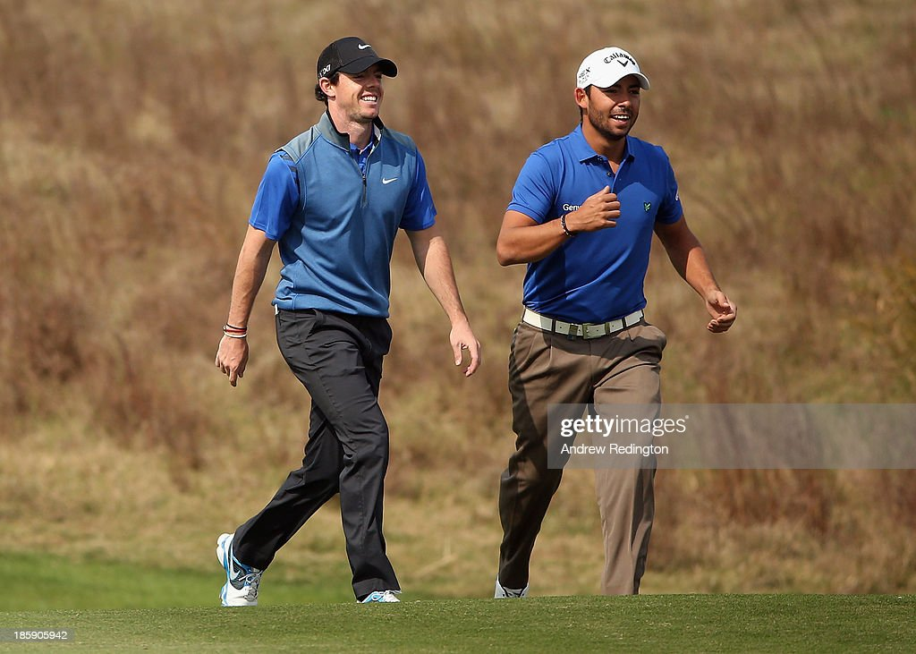 <a gi-track='captionPersonalityLinkClicked' href=/galleries/search?phrase=Rory+McIlroy&family=editorial&specificpeople=783109 ng-click='$event.stopPropagation()'>Rory McIlroy</a> of Northern Ireland (left) shares a joke with <a gi-track='captionPersonalityLinkClicked' href=/galleries/search?phrase=Pablo+Larrazabal&family=editorial&specificpeople=4022842 ng-click='$event.stopPropagation()'>Pablo Larrazabal</a> of Spain on the second hole during the third round of the BMW Masters at Lake Malaren Golf Club on October 26, 2013 in Shanghai, China.