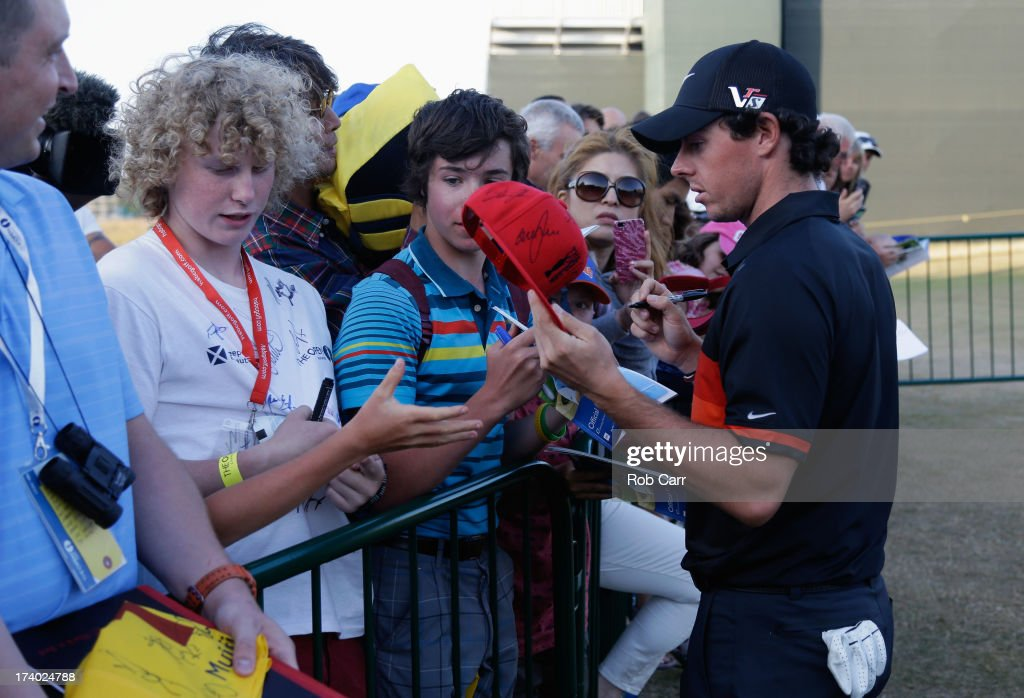 Rory McIlroy of Northern Ireland signs autographs after finishing the second round of the 142nd Open Championship at Muirfield on July 19, 2013 in Gullane, Scotland.