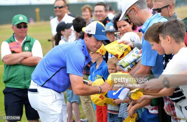 Rory McIlroy of Northern Ireland signs autographs ahead of the 142nd Open Championship at Muirfield on July 17 2013 in Gullane Scotland
